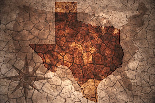 Texas state map on vintage usa map, crack paper background